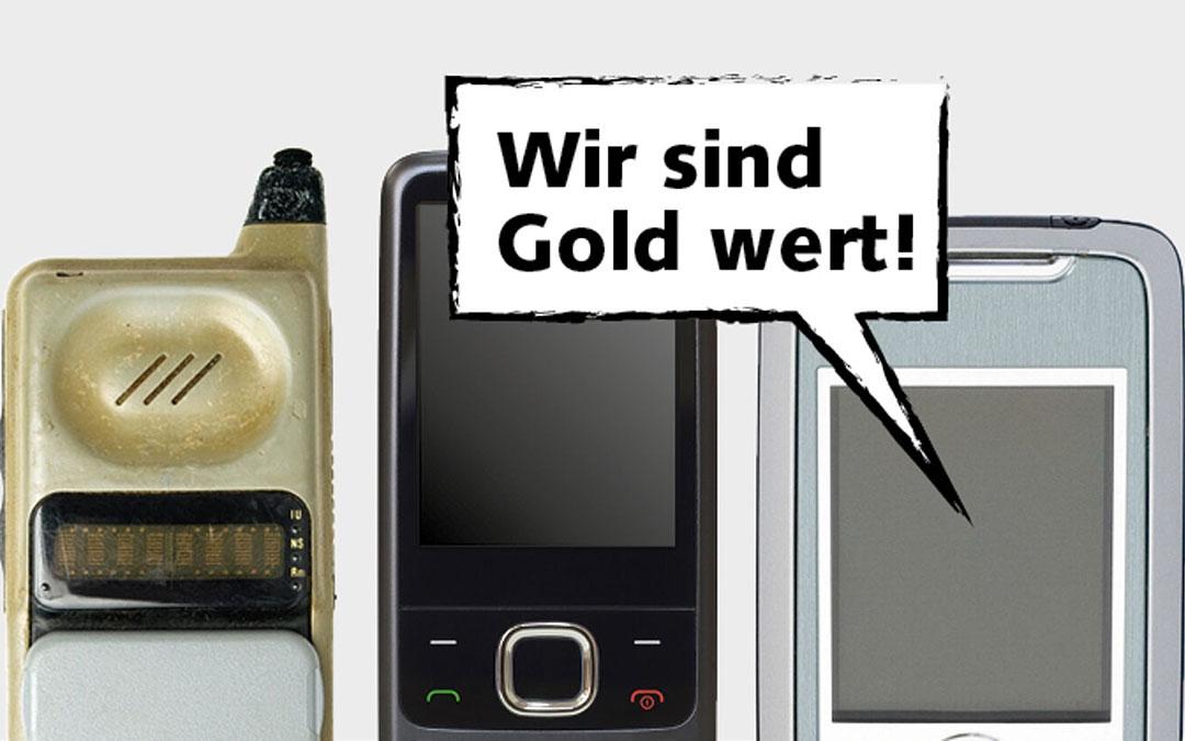 """Drei Mobiltelefone mit dem Text """"Wir sind Gold wert"""""""